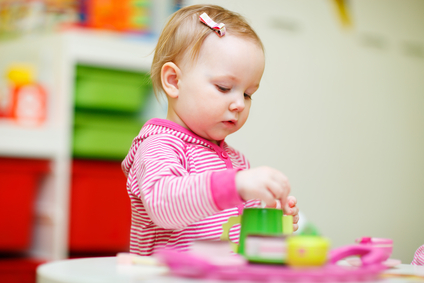 Toddler girl playing with toys