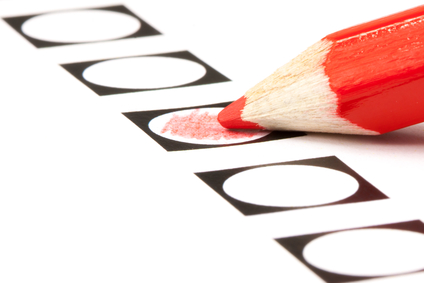Voting form with red pencil filling in a black circle