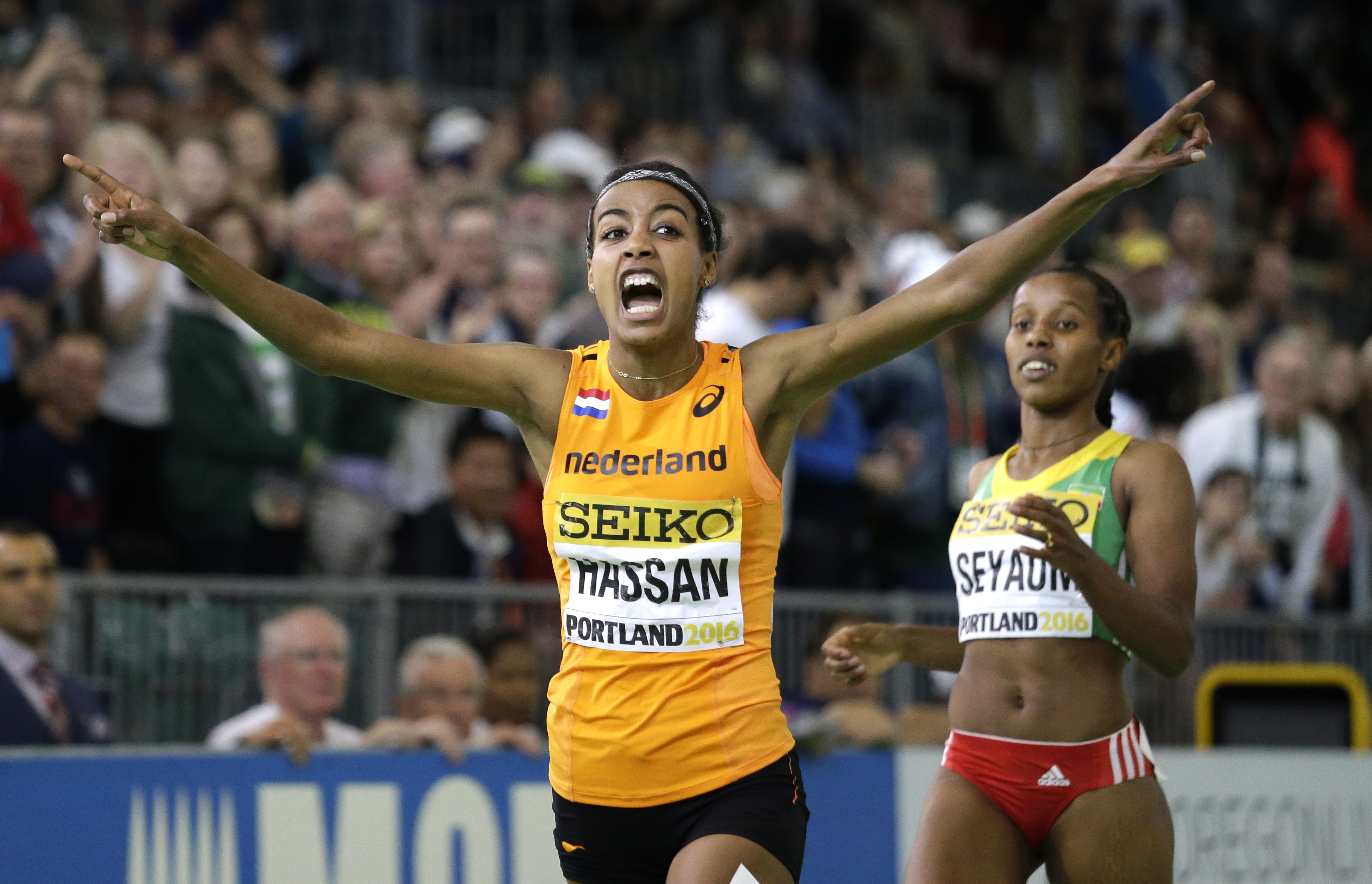 Sifan Hassan crosses the finishing line to take the world indoor 1,500 metres title. Photo: AP Photo/Elaine Thompson