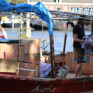 Former refugee boats now sail on calmer waters in Amsterdam