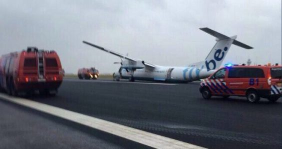 Storm disrupts train and air travel, plane crashes off runway at Schiphol