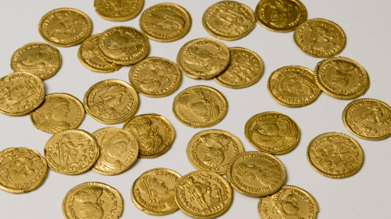 Hoard Of Roman Coins Found At Former Burial Site In