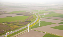 Dutch farm landscape with windmills and road from above, The Netherlands