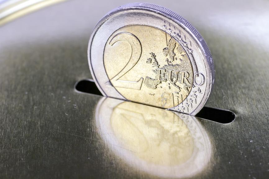 saving two euros in a piggy bank