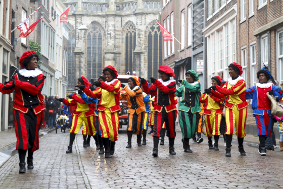 Dancers dressed as Zwarte Piet