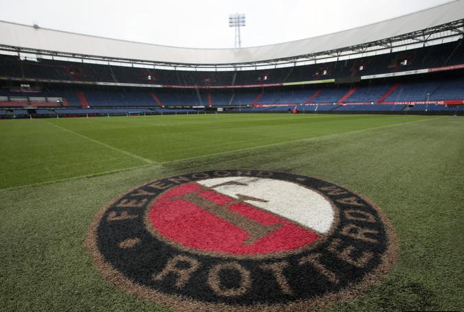 Feyenoord badge on the pitch in De Kuip stadium.