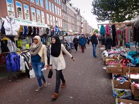 girls in headscarves in Amsterdam market