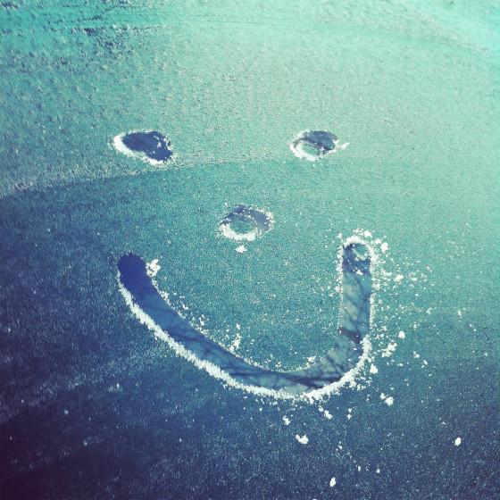 Smiley face on frozen windscreen