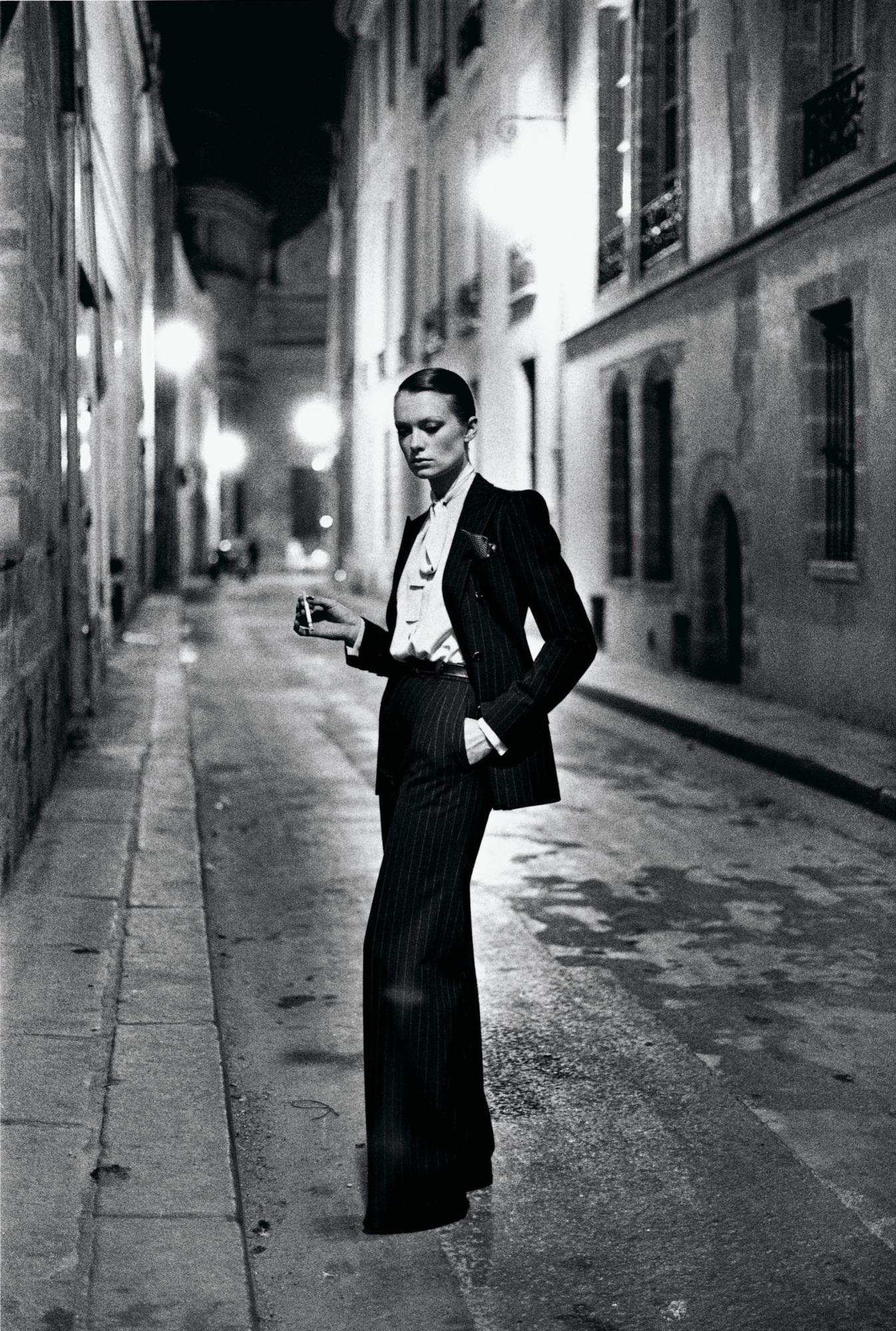 Photo: Yves Saint Laurent, French Vogue, Rue Aubriot, Paris 1975 © Helmut Newton / Helmut Newton Estate