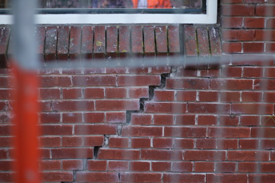 Cracks in the wall of a property damaged by earthquakes. Photo: Graham Dockery