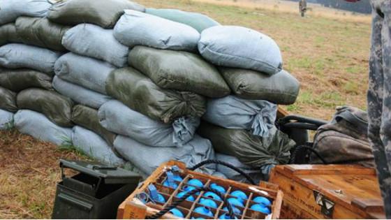 Box of hand grenades and sandbags