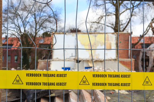 'No trespassing asbestos' at a demolition site. Photo: Depositphotos.com