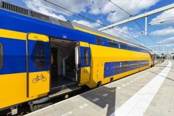 Image of NS double decker Dutch train sitting in station