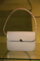 A white leather handbag worn by Britain's Queen Elizabeth.