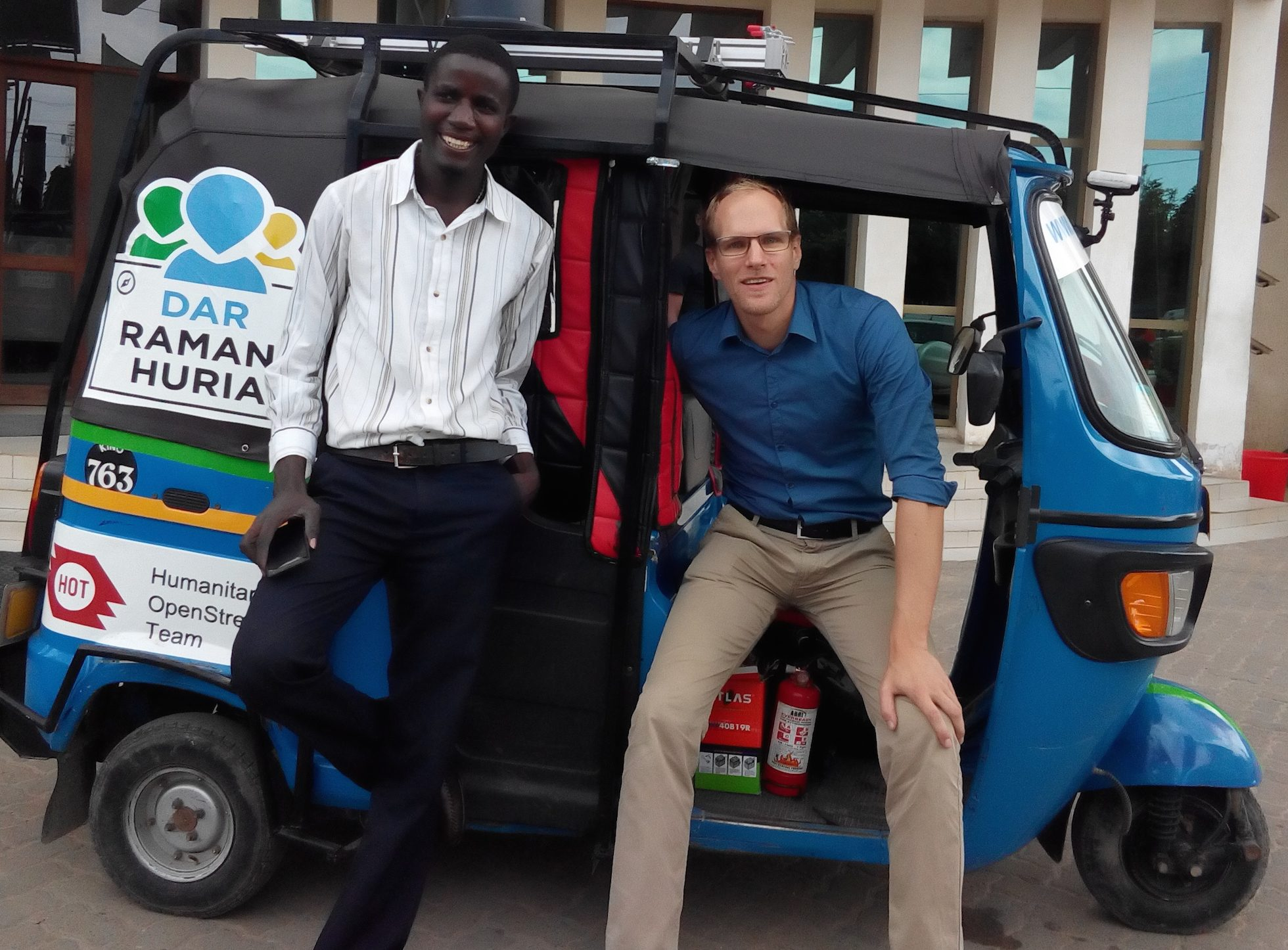 Map maker Paul Uithol (right) in Dar es Salaam, Tanzania