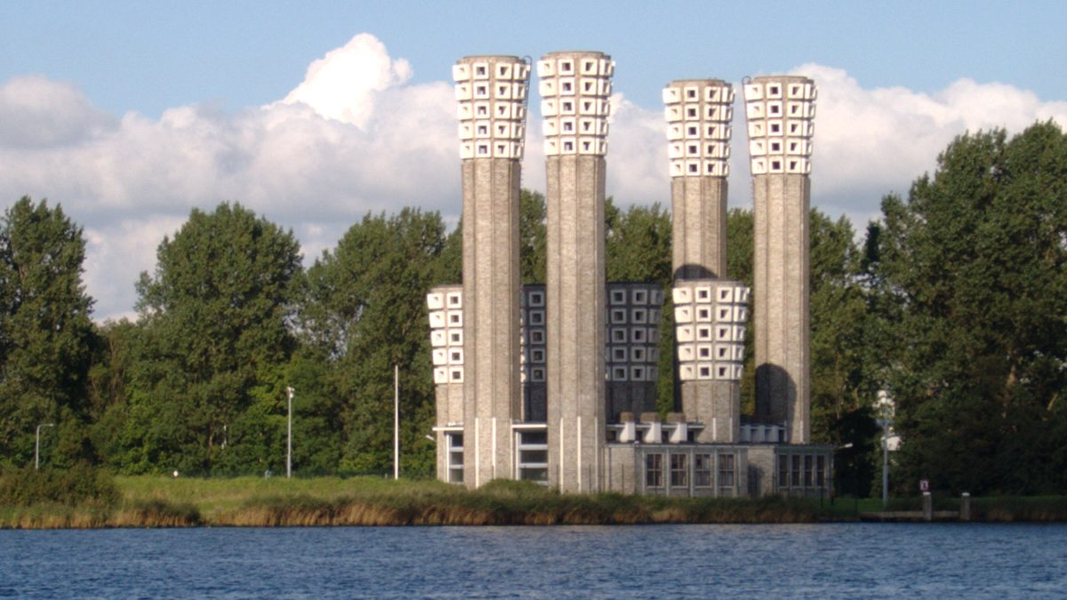 The grey concrete ventilation towers for the Velsertunnel on the north bank of the IJ in the Netherlands.