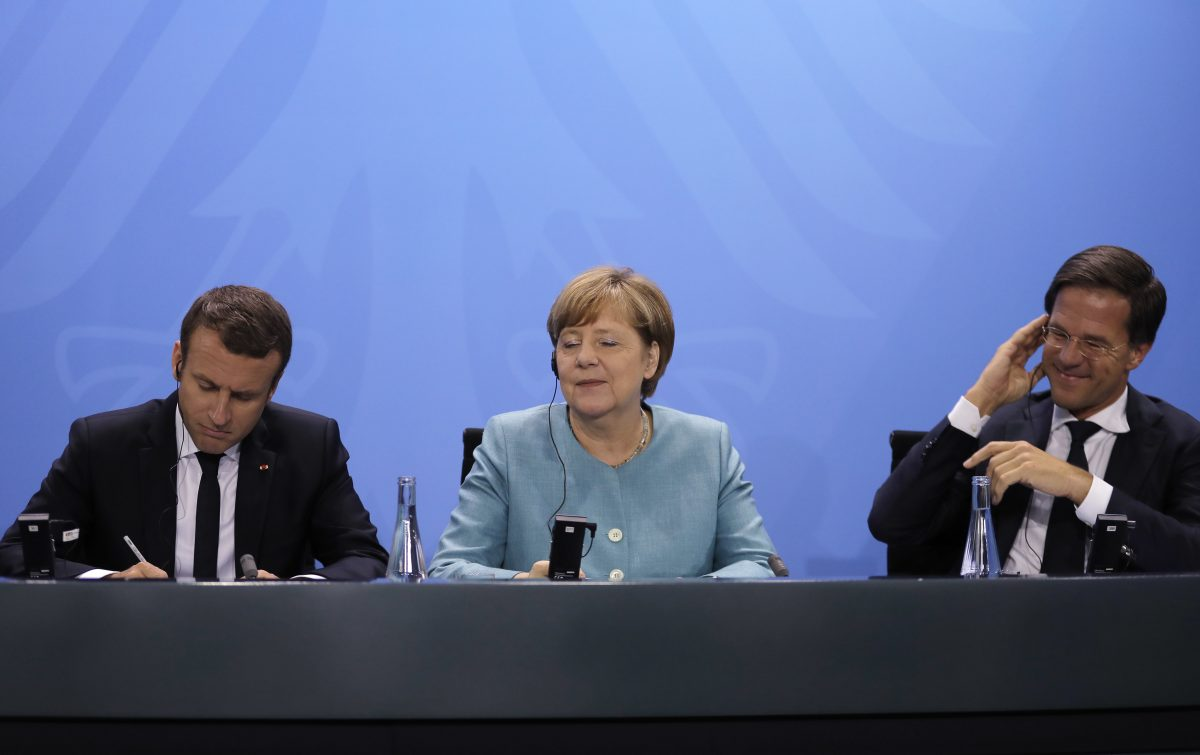 French president Emmanuel Macron, German chancellor Angela Merkel and Dutch prime minister Mark Rutte