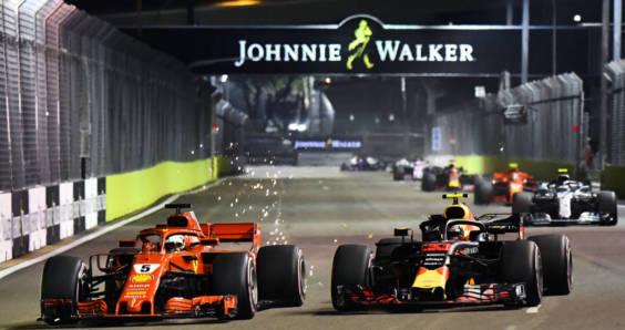Sebastian Vettel's Ferrari overtaking Max Verstappen in a Red Bull on the opening lap of the Singapore Grand Prix.