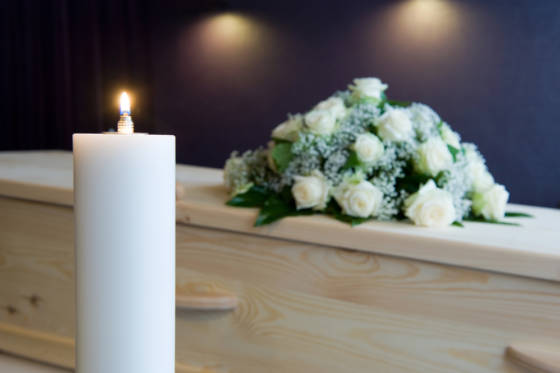 Burning candle in mortuary funeral death