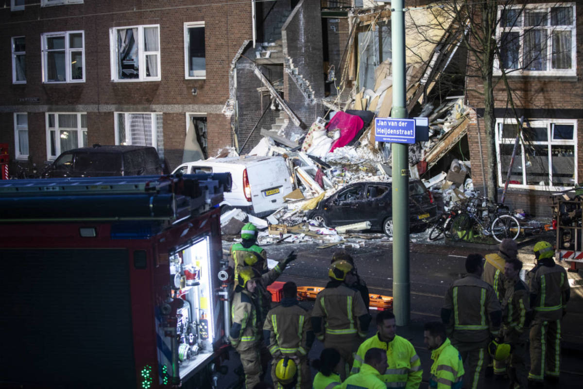 Rescue workers at the scene of a gas explosion in Jan van der Heijedenstraat, The Hague, where a man was trapped and nine people have been injured in a gas explosion.