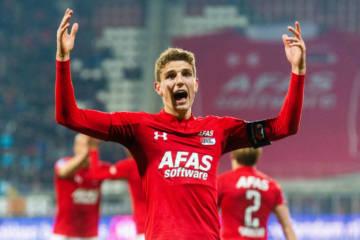 Guus Til of AZ Alkmaar raises his arms to celebrate scoring the opening goal against VVV Venlo.
