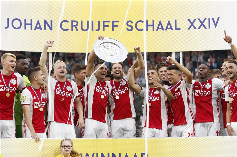 Ajax players raise the Johan Cruyff Shield after beating PSV 2-0.