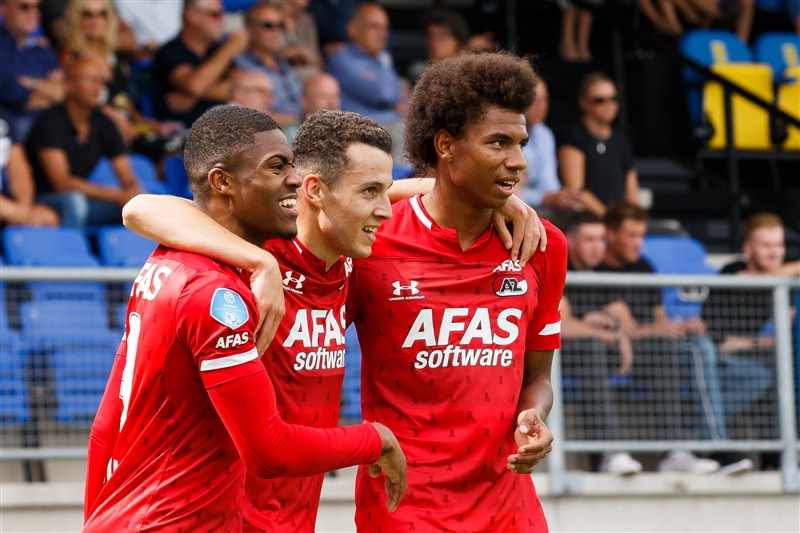 Oussama Idrissi, who scored both goals in AZ Alkmaar's 2-0 win against RKC Waalwijk, celebrating with team-mates Myron Boadu and Calvin Stengs.