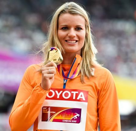 Dafne Schippers holding up her gold medal at the World Athletics Championships in London in 2017.