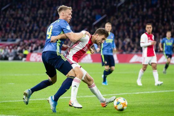 Nicolai Jorgensen of Feyenoord and Joel Veltman of Ajax contesting the ball
