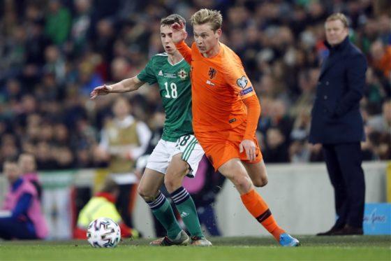 Frenkie de Jong and Gavin Whyte jostling for possession