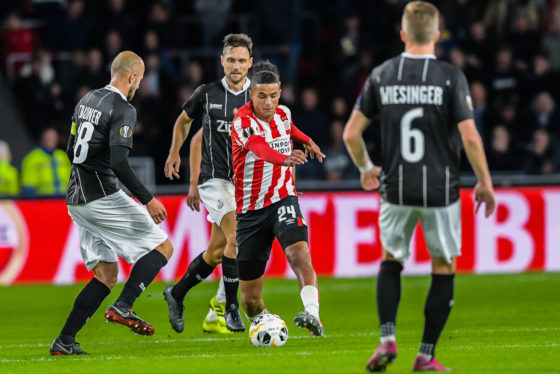PSV midfielder Mohamed Ihattaren on the ball surrounded by defenders during a match against LASK Linz of Austria.