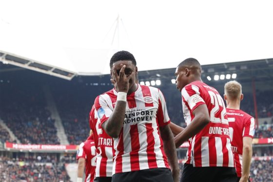 Steven Bergwijn covers his face with his hand to celebrate scoring against Heerenveen