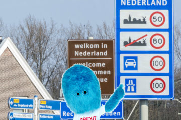 Brexit muppet pointing to a 100km/h road sign