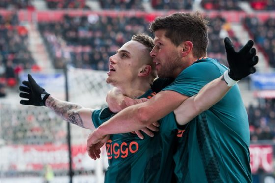 Noa Lang holding his arms outstretched as he celebrates with Klaas-Jan Huntelaar