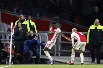 Quinsy Promes dances by the corner flag to celebrate his 35-minute goal.