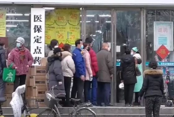 People queuing for supplies in Wuhan