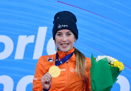 Lara van Ruijven holding her gold medal and a bunch of flowers at the ceremony following her victory at the World Short Track Speed Skating Championships in 2019.