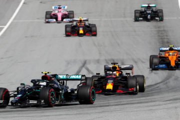 Max Verstappen running in second place on the first lap of the race