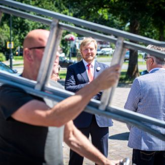 King Willem-Alexander photographed through the rungs of Herman Dinius's ladder.