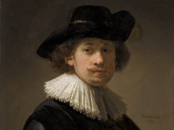 Detail of Rembrandt's self-portrait showing his face, hat and ruff.