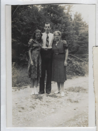 Black and white photograph of Harry Farrington flanked by his sister, Edith, and mother, Bertha.
