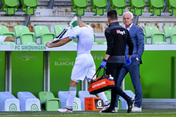 Arjen Robben leaving the field with his shirt pulled over his head.
