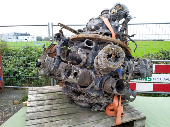 The mangled wreckage of the engine of the BK716 presented on a table at the recovery site.