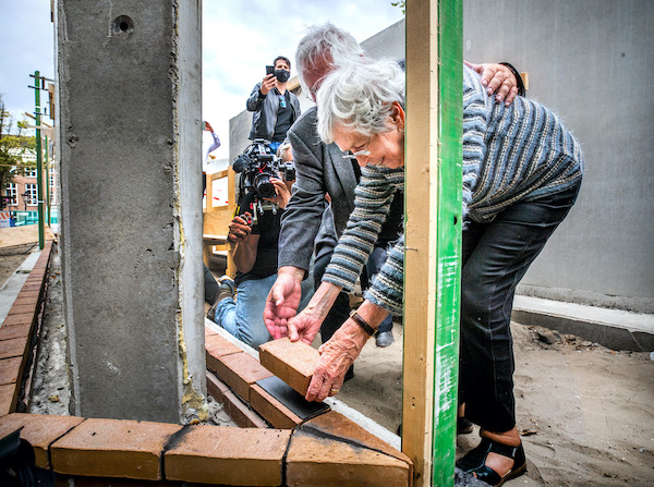 Anne Frank's childhood friend lays first brick for Nazi victims monument - DutchNews.nl