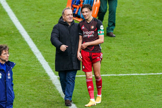 Feyenoord manager Dick Advocaat holding Steven Berghuis by the shoulders on the touchline.