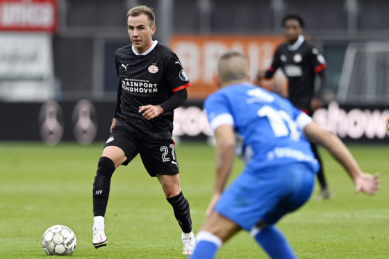 Mario Götze with the ball for PSV EIndhoven against an unidentified PEC Zwolle defender