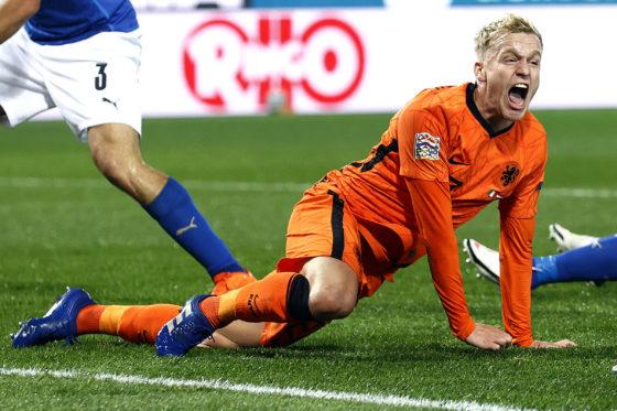 Midfielder Donny van de Beek roaring with delight as he crouches after scoring the equaliser.