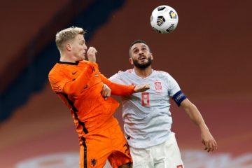 Donny van de Beek in orange rising to head the ball