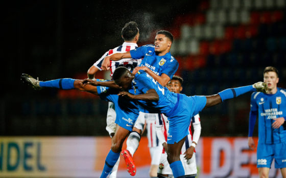 Danilho Doekhi and Idrissa Toure of Vitesse Arnhem, playing in blue, tangle for the ball during the 3-1 win over Willem II in Tilburg.
