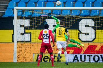 Vitesse Arnhem goalkeeper Remko Pasveer making a flying save from Emmen